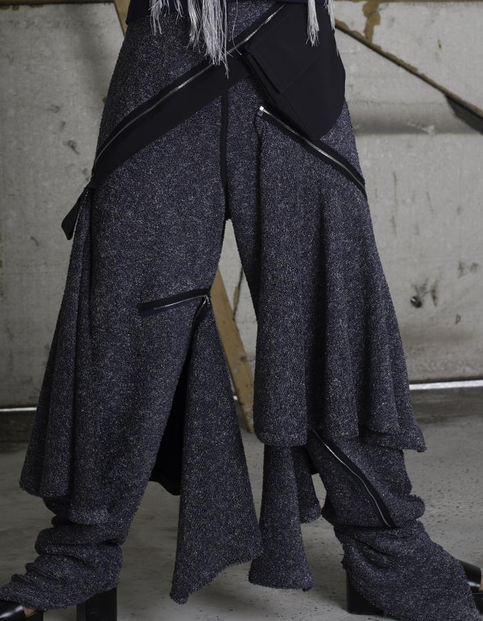 Carpenter trouser in glitter knit jersey with zip off flounce and fall proof fabric.