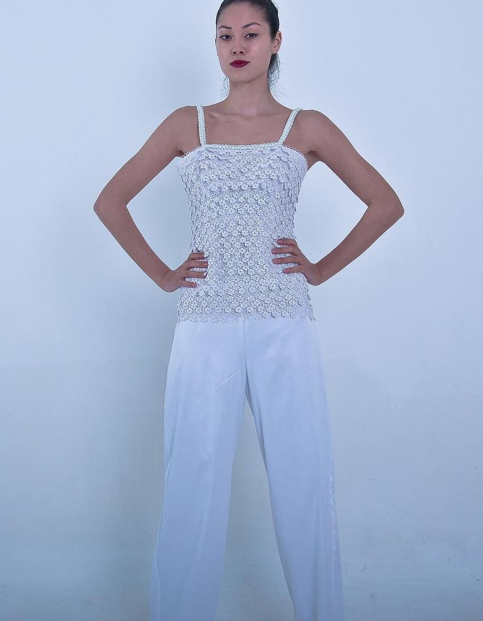 A white jumpsuit handmade with laces bodice and sleeveless.