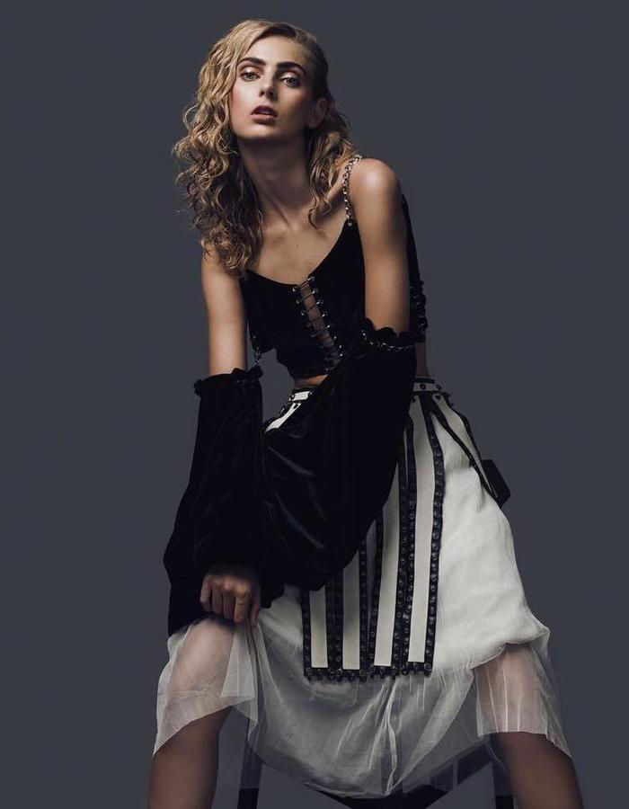 THIAN Rodriguez black crop top with detachable sleeves and gladiator skirt.