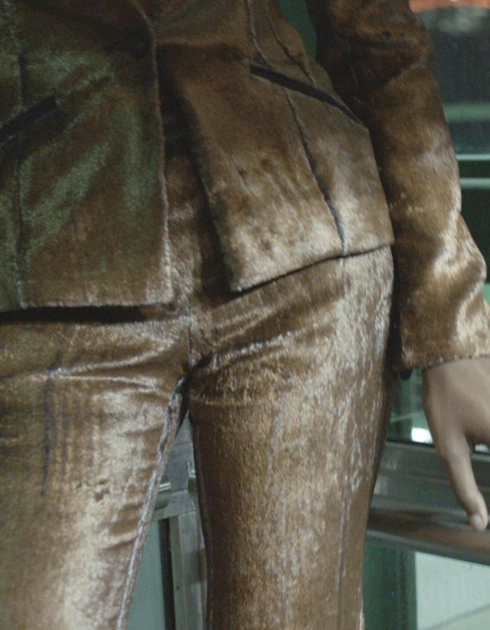 A closeup of the metallic foiled silk velvet suit as worn in the 2017 WALDMANN Fashion Film.
