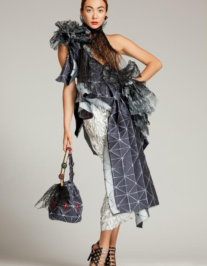 """Unique piece - """"NEMESIA"""" SIMON ALBO Couture Collection 2018. © SIMON ALBO Jabot in black silk tulle. Asymmetrical silk dress with geometric patterns in steel and slate, adorned with shaped organza petals. Silver pleated lurex skirt. Silk purse bag, embroidered with pearls and rope.simon albo creative fashion designer costumier haute couture luxe mode blue black transparent famous"""